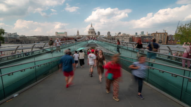 time-lapse: pedestrian commuter crowd at millennium bridge with st paul's cathedral in london england uk - london millennium footbridge stock videos & royalty-free footage
