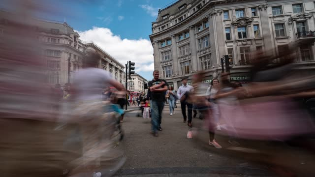 time-lapse: pedestrian commuter crowd at oxford circus downtown shopping street in london england uk - image stock videos & royalty-free footage