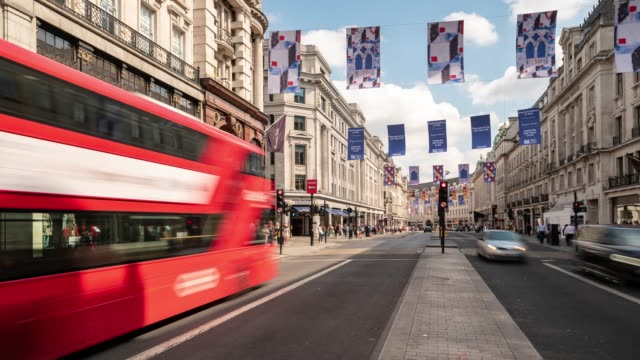 time-lapse: pedestrian commuter crowd at oxford circus downtown shopping street in london england uk - oxfordshire stock videos and b-roll footage