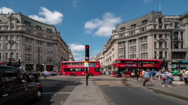 time-lapse: pedestrian commuter crowd at oxford circus downtown shopping street in london england uk - oxford circus stock videos and b-roll footage