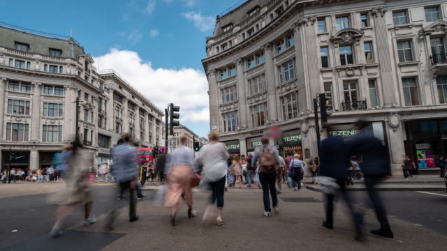 time-lapse: pedestrian commuter crowd at oxford circus downtown shopping street in london england uk - geographical locations stock videos & royalty-free footage