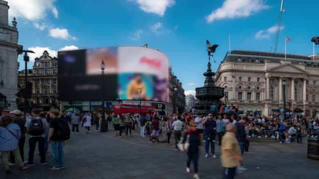 time-lapse: pedestrian commuter crowd at piccadilly circus downtown in london england uk - double decker bus stock videos & royalty-free footage