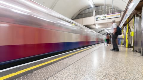 time-lapse: pedestrian commuter crowd at subway tube platform in london england uk - underground station platform stock videos & royalty-free footage