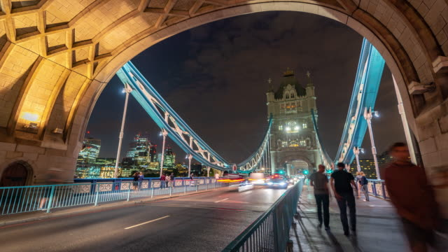 time-lapse: pedestrian commuter crowd at tower bridge in london england uk sunset night - tower bridge stock videos & royalty-free footage