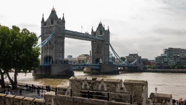 time-lapse: pedestrian commuter crowd at tower bridge in london england uk - tower bridge stock videos & royalty-free footage