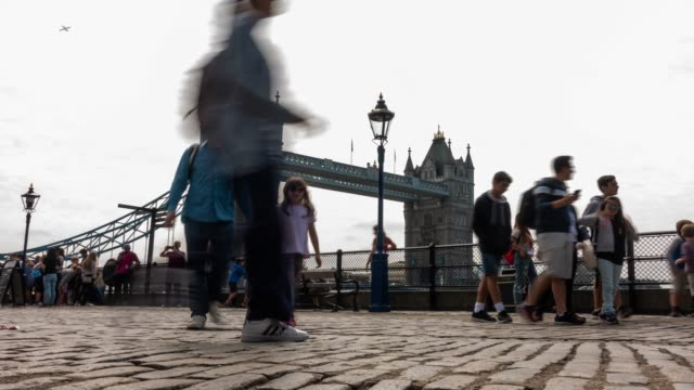 time-lapse: pedestrian commuter crowd at tower bridge in london england uk - tower of london stock videos and b-roll footage