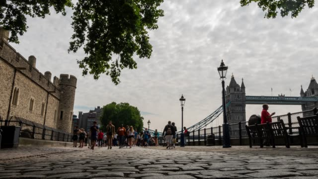 time-lapse: pedestrian commuter crowd at tower bridge in london england uk - tower of london stock videos & royalty-free footage