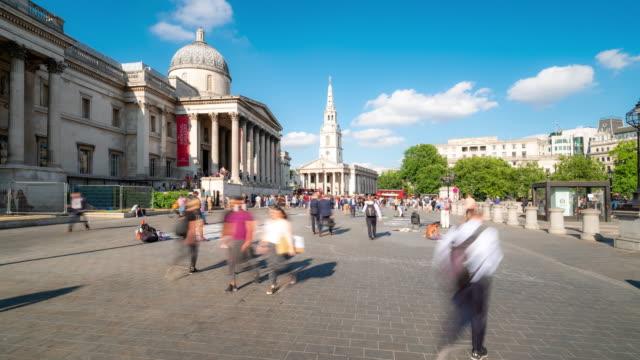 time-lapse: pedestrian commuter crowd at trafalgar square in london england uk - bokeh museum stock videos & royalty-free footage