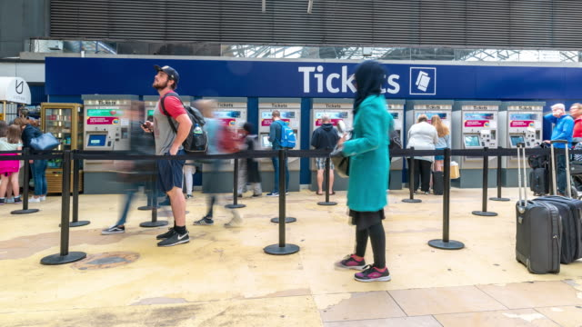 Time-lapse Pedestrian Commuter Crowd at train station ticket floor in Glasgow scotland UK
