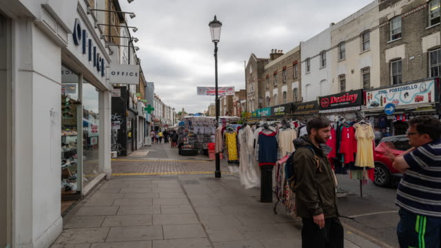 Time-lapse: Pedestrian Crowd at Notting Hill flea market in west London England UK