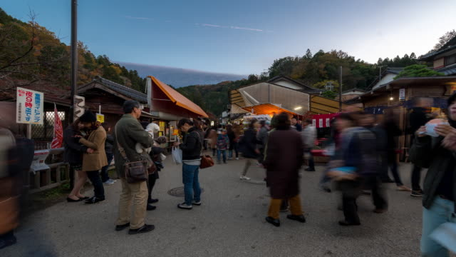 time-lapse: pedestrian crowded at korankei flea market autumn nagoya japan - market stall stock videos & royalty-free footage