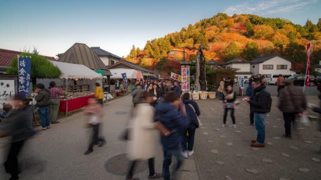 time-lapse: pedestrian crowded at korankei flea market autumn nagoya japan - flea market stock videos and b-roll footage