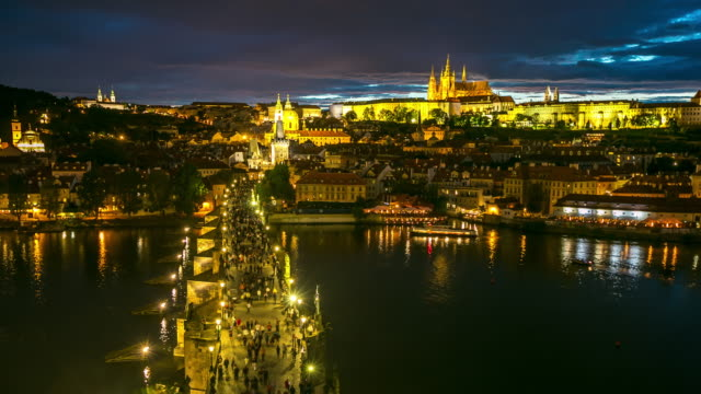 4k time-lapse: pedestrian crowded charles bridge czech aerial at dusk - mala strana stock videos and b-roll footage