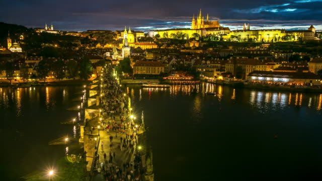 4K Time-lapse: Pedestrian Crowded Charles Bridge Czech aerial at dusk