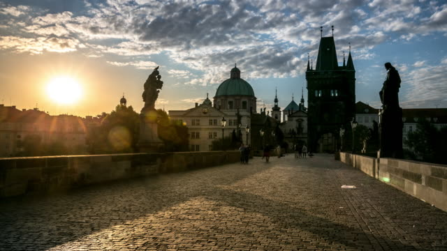 4k time-lapse: pedestrian crowded charles bridge karluv most czech sunrise - charles bridge stock videos & royalty-free footage