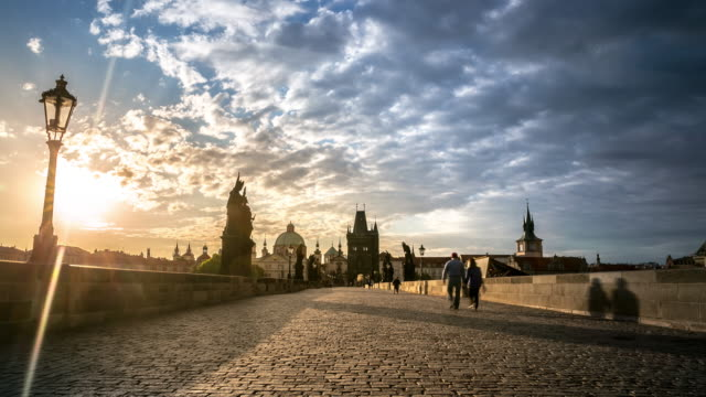 4k time-lapse: pedestrian crowded charles bridge karluv most czech sunrise - prague stock videos & royalty-free footage