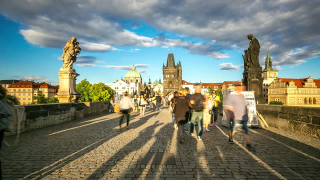 4k time-lapse: pedestrian crowded charles bridge karluv most czech republic - prague bridge stock videos and b-roll footage