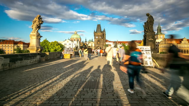 4k time-lapse: pedestrian crowded charles bridge karluv most czech republic - mala strana stock videos and b-roll footage