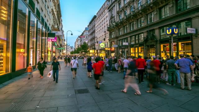 4K Time-lapse: Pedestrian Crowded Kartner shopping street Vienna Austria dusk