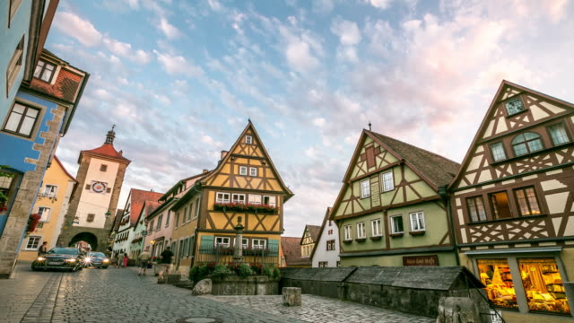 4k time-lapse: pedestrian crowded rothenburg ob der tauber bavaria, germany - rothenburg stock videos and b-roll footage