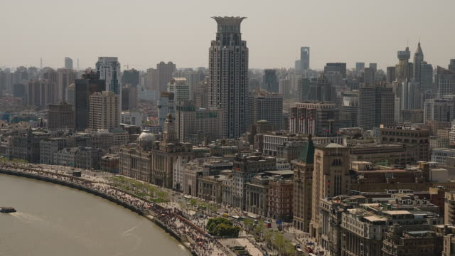 Time-lapse pedestrian traffic along The Bund in central Shanghai, on the banks of the Huangpu River