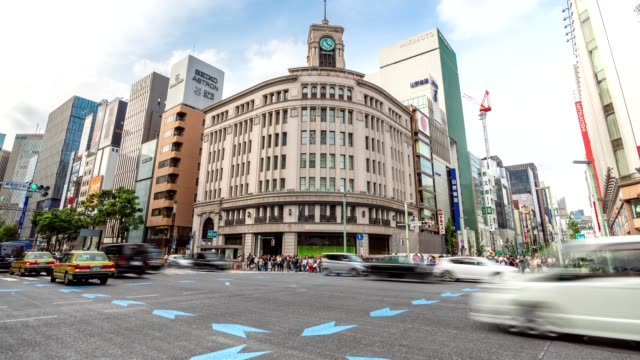 4k time-lapse: pedestrians and car crowd at intersection cross-walk ginza crosswalk car traffic on tokyo, japan. tilt up shot - ginza stock videos & royalty-free footage
