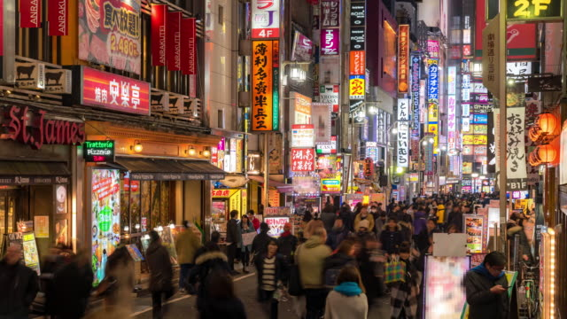 time-lapse: pedestrians and tourist crowded at kabuki-cho shinjuku tokyo - composite image stock videos & royalty-free footage