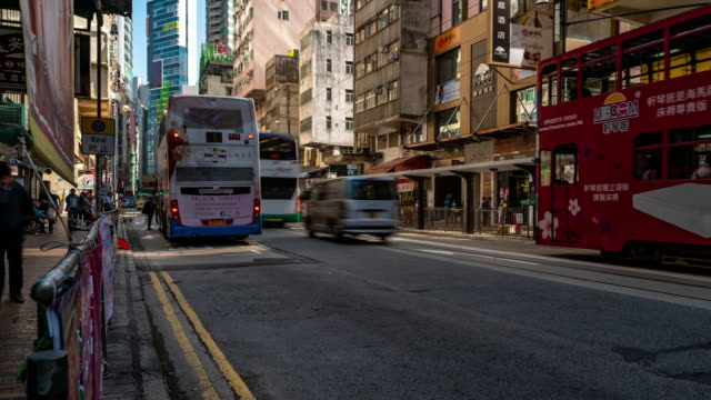 time-lapse: pedestrians and transportation background at western market dried seafood and tonic food streets, sheung wan, hong kong downtown - old town stock videos & royalty-free footage