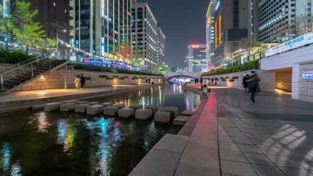 time-lapse: pedestrians at cheonggyecheon canal at seouk downtown south korea at night - south korea stock videos & royalty-free footage