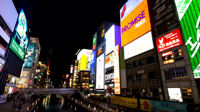 hd time-lapse: pedestrians at dotonbori osaka - stock video - dolly shot stock videos and b-roll footage