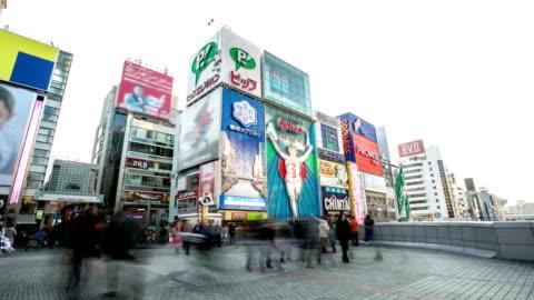 hd time-lapse: pedestrians at dotonbori osaka - satoyama scenery stock videos & royalty-free footage