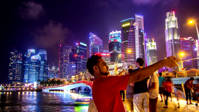 hd time-lapse : pedestrians at marina bay singapore. - marina stock videos & royalty-free footage