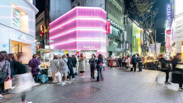 time-lapse: pedestrians at myeongdong downtown shopping street in seoul south korea at night - cross section stock videos & royalty-free footage