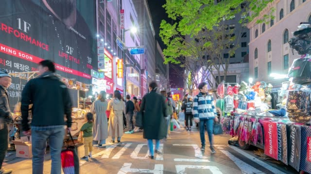 time-lapse: pedestrians at myeongdong downtown shopping street in seoul south korea at night - seoul stock videos & royalty-free footage