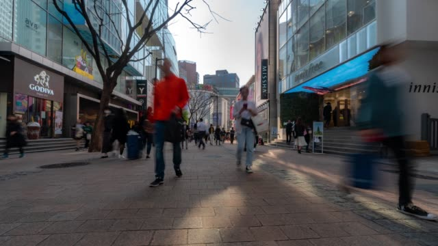 time-lapse: pedestrians at myeongdong downtown shopping street in seoul south korea - cross section stock videos & royalty-free footage