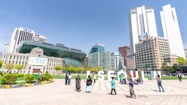 time-lapse: pedestrians at seoul downtown and city hall area south korea - town hall government building stock videos & royalty-free footage