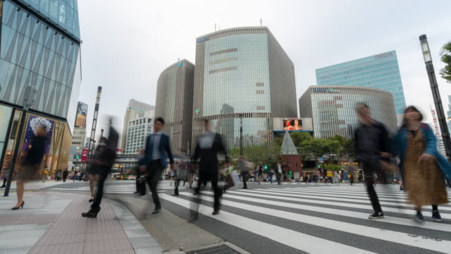 Time-lapse: Pedestrians cross at Ginza Crossing Tokyo Japan