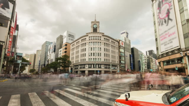 hd time-lapse: pedestrians cross at ginza crossing - ginza stock videos & royalty-free footage
