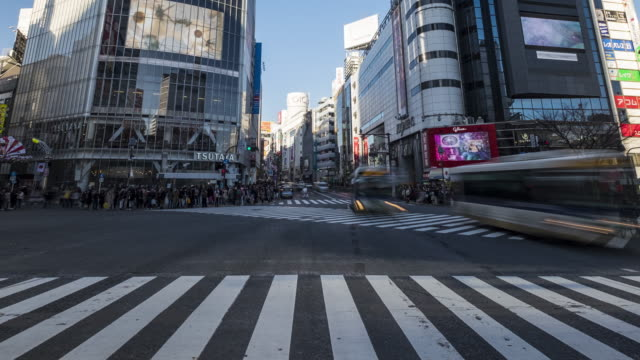 4k time-lapse: pedestrians cross at shibuya crossing, tokyo, japan - japanese culture stock videos & royalty-free footage