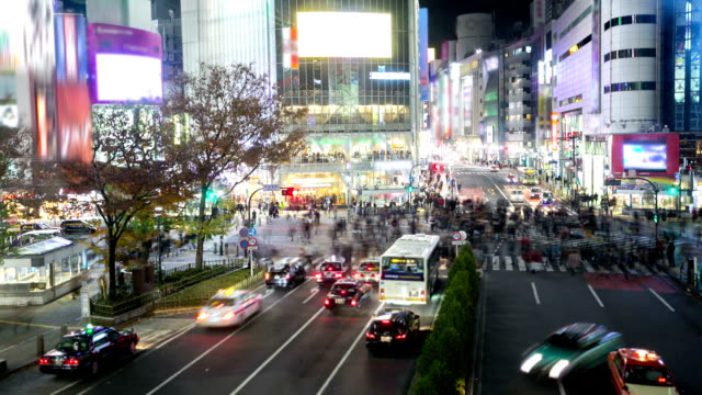 hd time-lapse: pedestrians cross at shibuya crossing - tokyo japan stock videos and b-roll footage