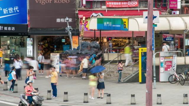 Time-Lapse: Pedestrians crowd Ximending shopping street Ximen, Taipei Taiwan