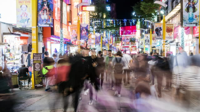 time-lapse: pedestrians crowd ximending shopping street ximen, taipei taiwan - taiwan stock videos and b-roll footage