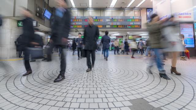 time-lapse: pedestrians crowded at shinjuku station tokyo - station stock videos & royalty-free footage
