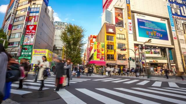 4k time-lapse: pedestrians crowded at shinjuku tokyo - shinjuku ward stock videos & royalty-free footage