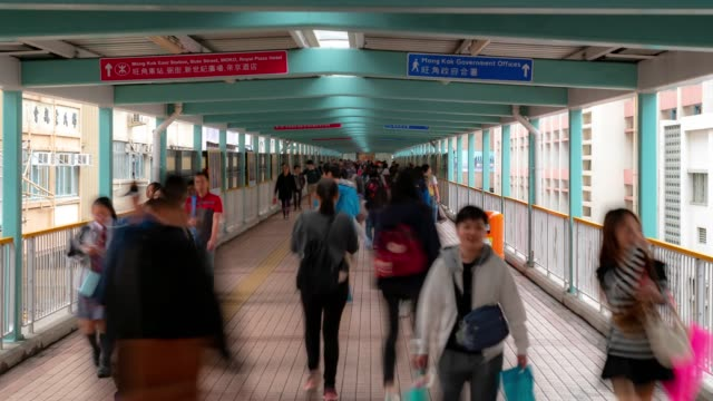 time-lapse: pedestrians crowded at skywalk in kowloon hong kong - footbridge stock videos & royalty-free footage