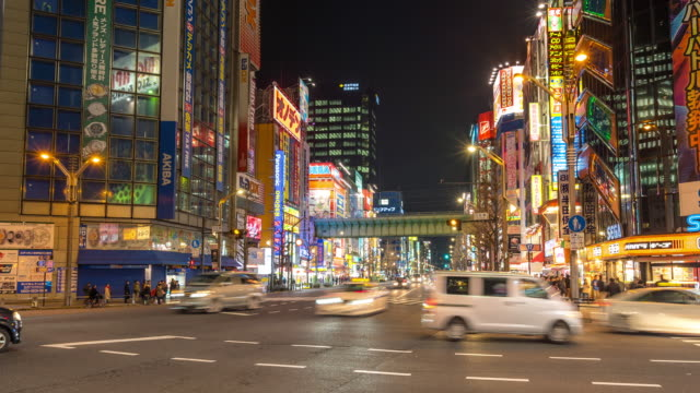 time-lapse: pedestrians crowded shopping akihabara electric town tokyo night - akihabara stock videos and b-roll footage