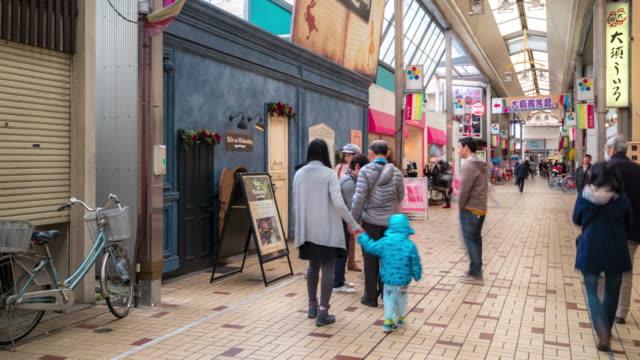 time-lapse: pedestrians crowded shopping osu kannon shopping arcade nagoya japan - guanyin bodhisattva stock videos & royalty-free footage