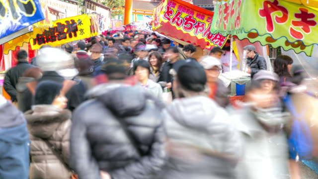time-lapse: pedestrians shopping at fushimi inari market kyoto - shrine stock videos and b-roll footage