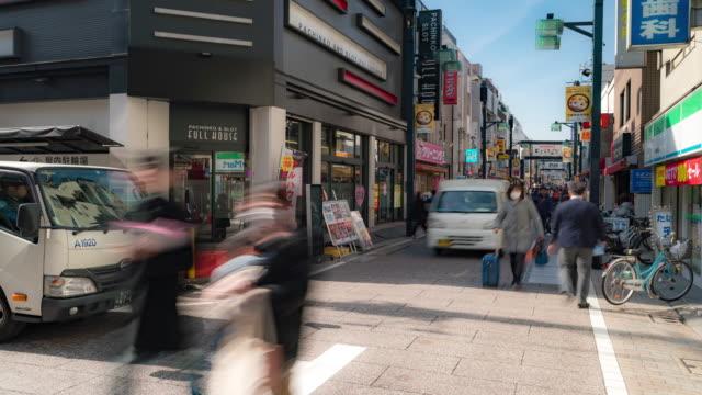 vídeos de stock, filmes e b-roll de time-lapse: pedestres turista lotado em togoshi-giza rua comercial shinagawa em tóquio japão - cultura japonesa
