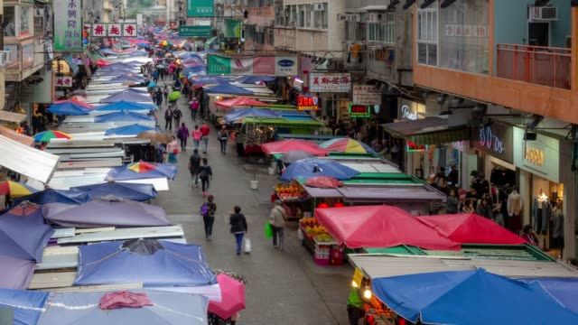 time-lapse: pedestrians tourist crowded shopping fa yuan flea market, mongkok, nathan road in kowloon hong kong - editorial stock videos & royalty-free footage